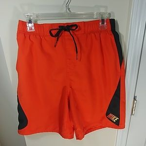 Orange Nike swim trunks
